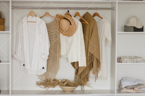 cozy clothes hanging in closet