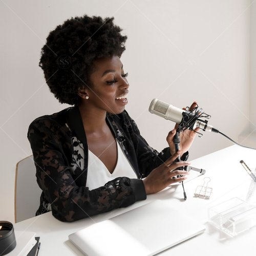woman of color speaking into microphone
