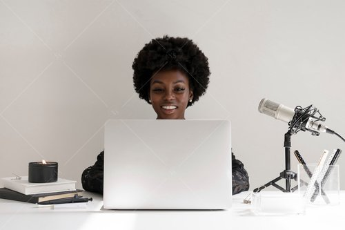 woman of color working at desk
