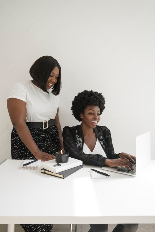 woman of color working together at desk