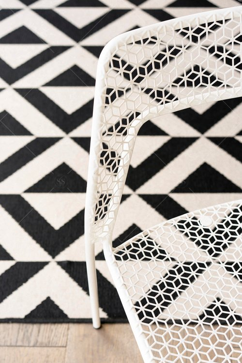 geometric black and white rug and chair