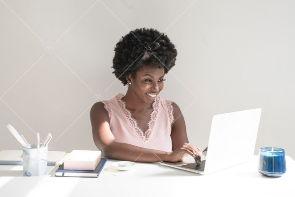 woman of color working on laptop