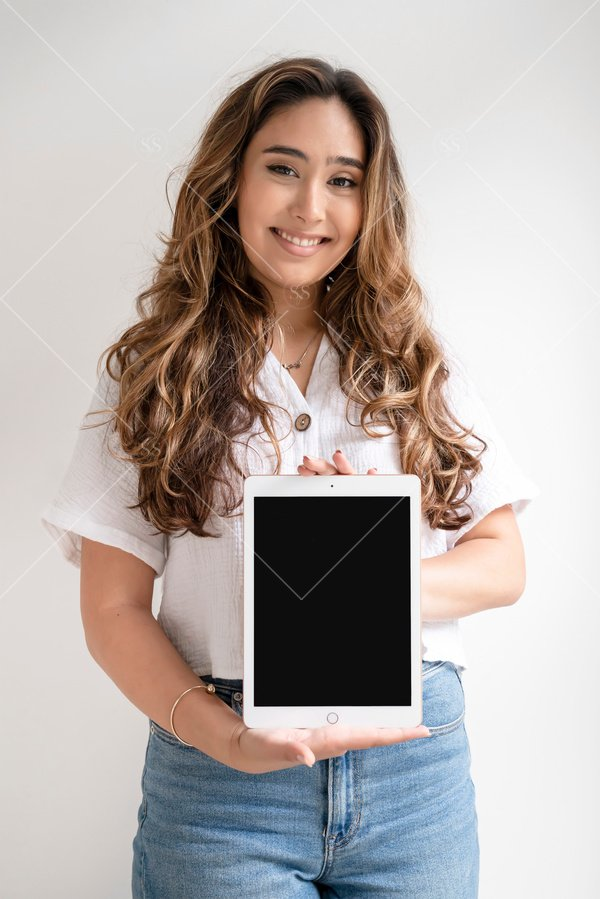 woman of color holding tablet mockup