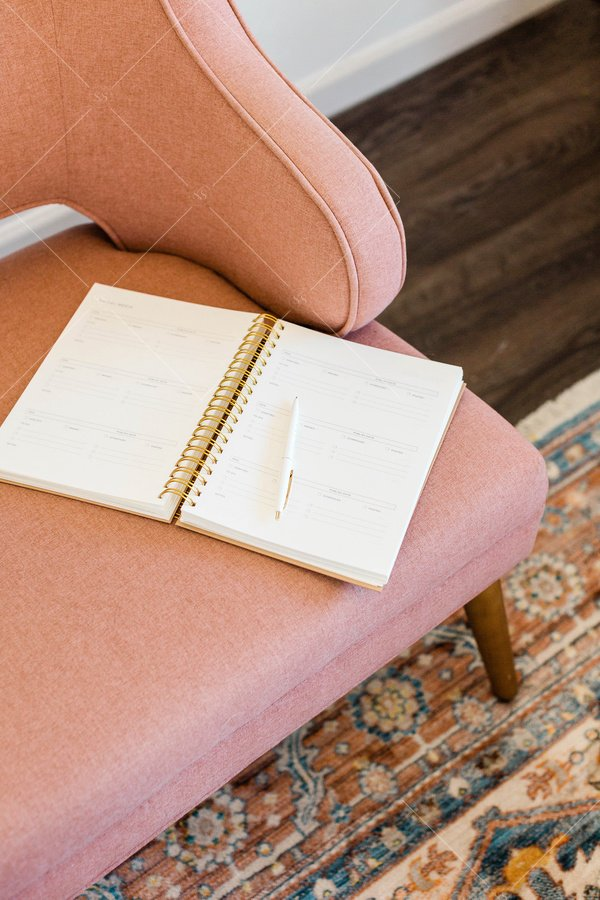 notebook sitting on armchair
