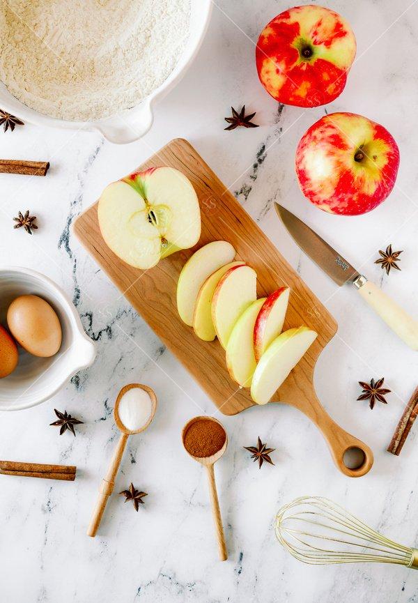 cutting up apples still life