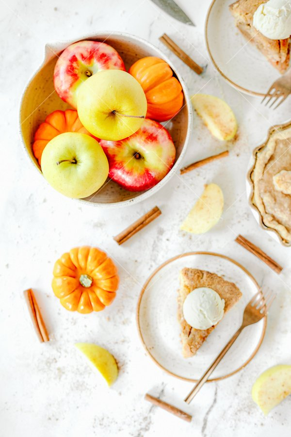 fall baking scene with apples and pie