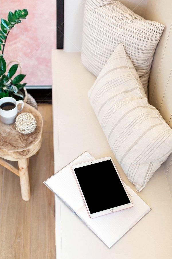 tablet mockup on living room sofa