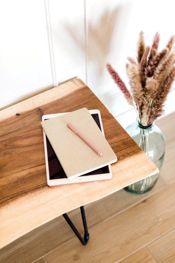 tablet and notebook mockups on bench