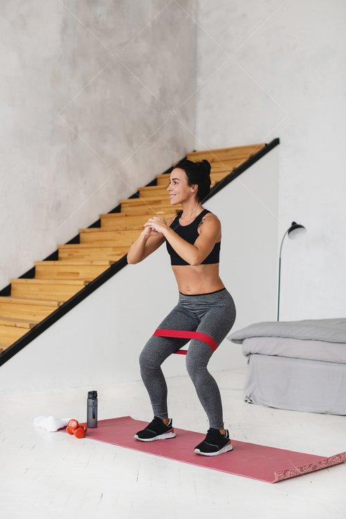 woman working out in bedroom