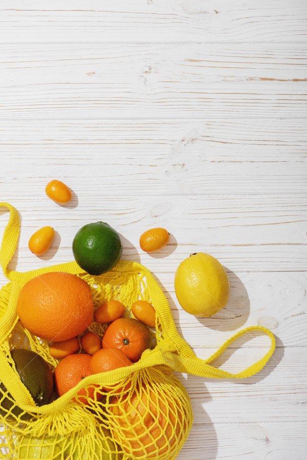 citrus fruit in string bag stock photo