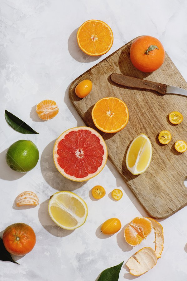 cutting up citrus fruit still life stock photo