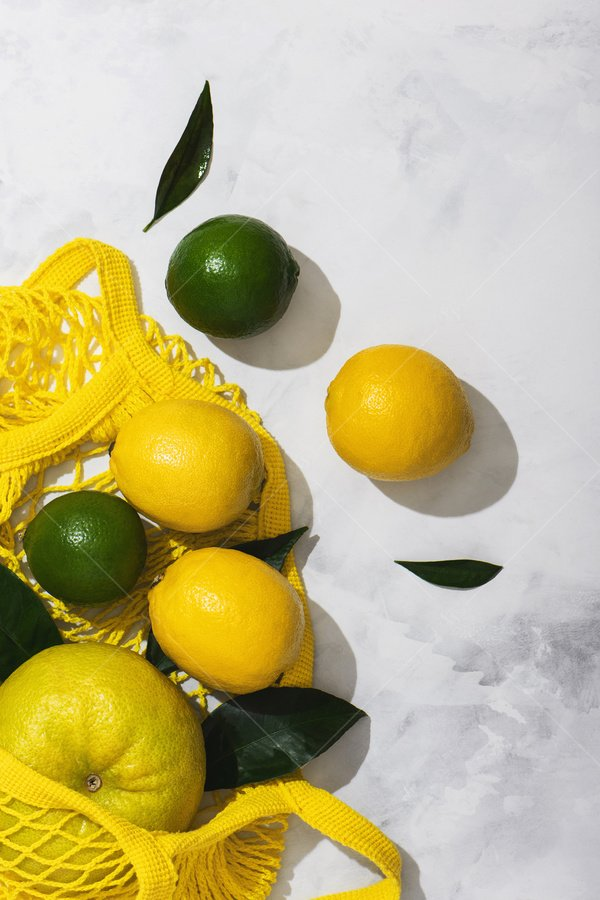 string bag full of citrus still life stock photo