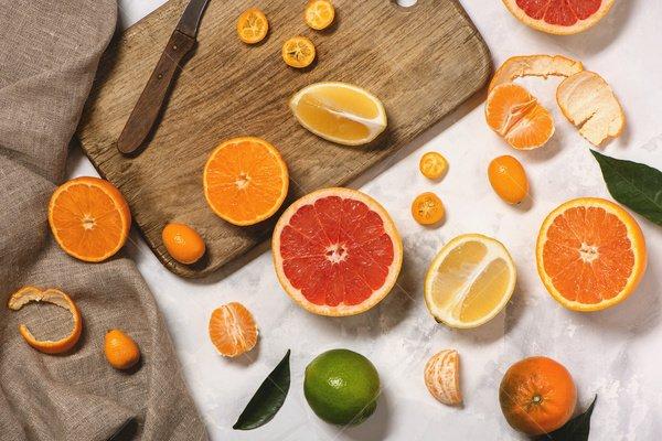 cutting up citrus still life stock photo