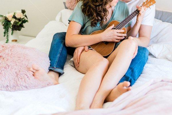 couple cuddling with ukulele