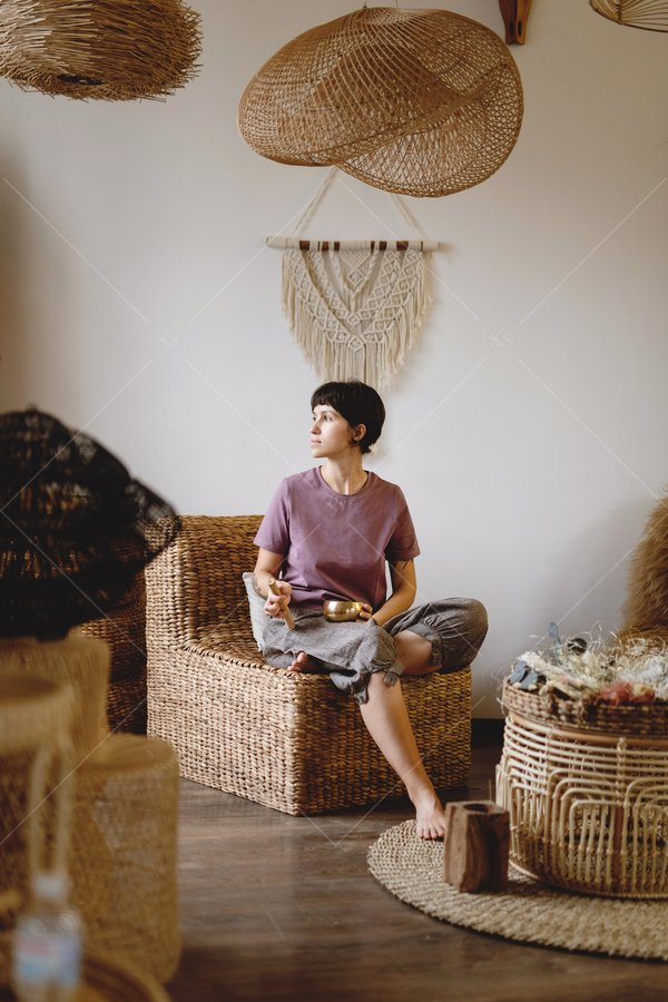 woman with singing bowl in living room