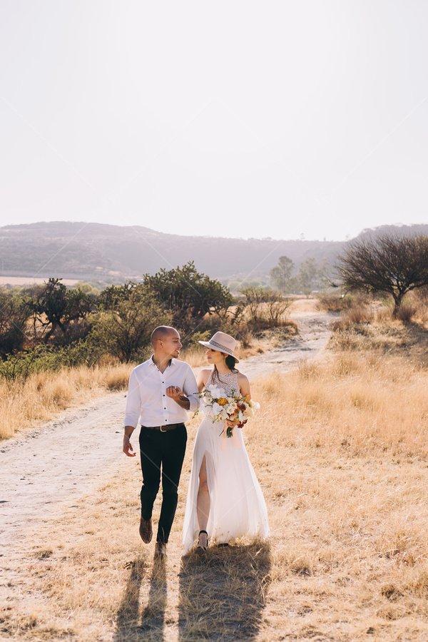 bride and groom desert stock photo