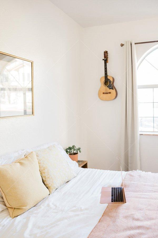 bedroom with laptop stock photo