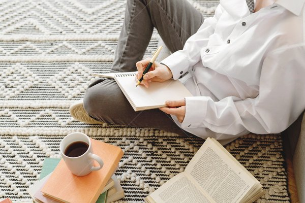 woman writing in living room stock photo