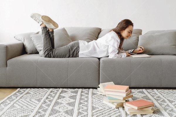 woman reading on sofa stock photo