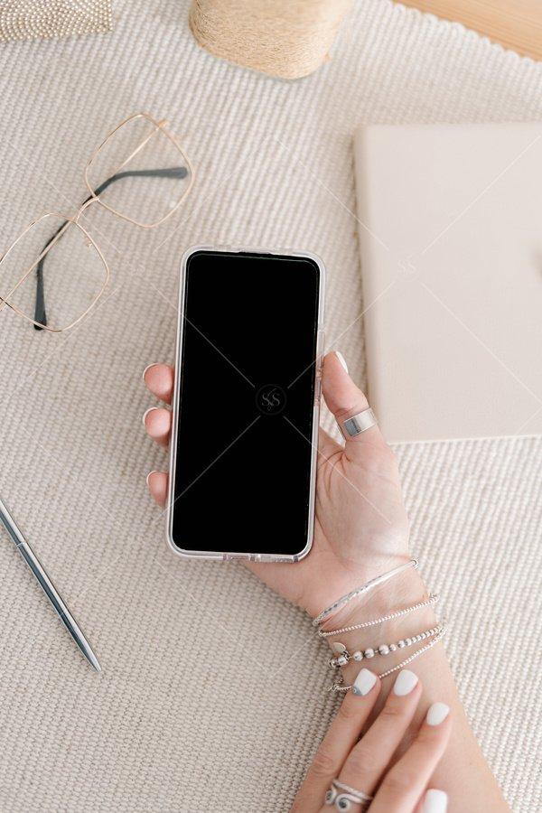 woman holding phone mockup stock photo