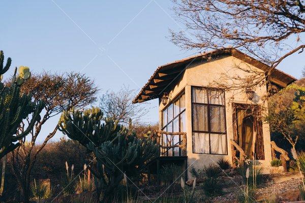 tiny house in desert landscape stock photo