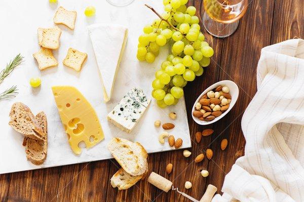 cheese board flat lay still life stock photo