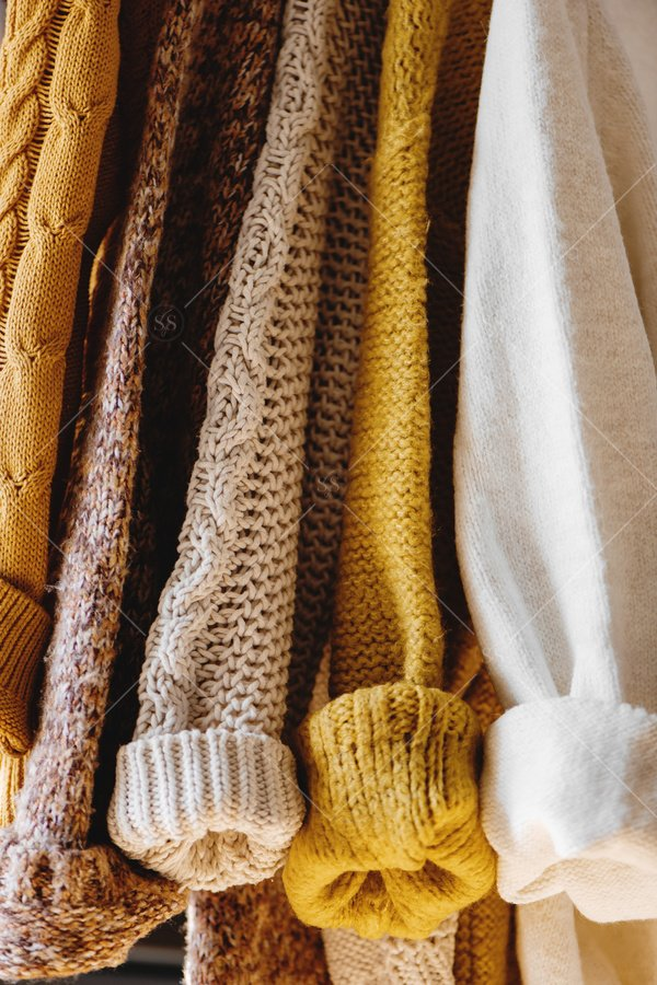 fall sweaters handing stock photo