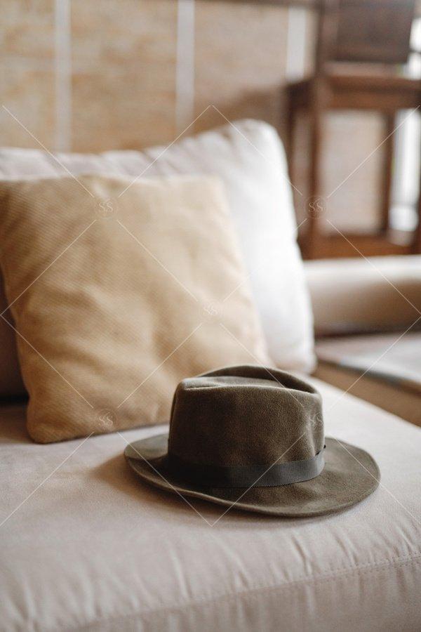 hat on sofa stock photo