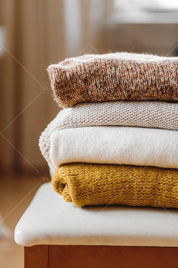 cozy fall sweaters stock photo