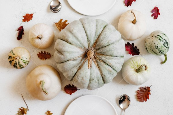 fall decor with pumpkins table setting stock photo