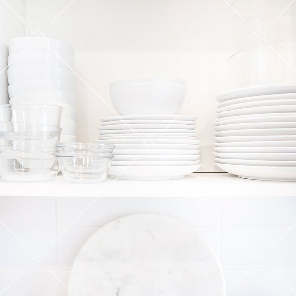 Organize kitchen cabinet with stacks of dishes