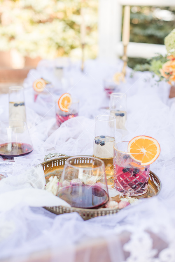 table, dinner, wedding, drinks, berries, juice, orange slices, tray, tulle, candles, florals, party,