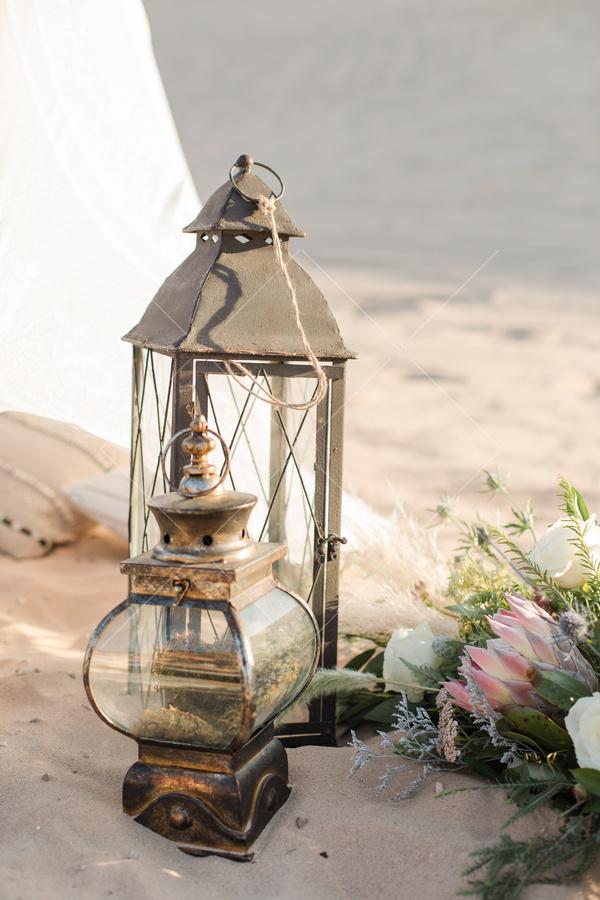 beach, sand, flowers, light, antique lantern, vintage lantern, pillows, tent,
