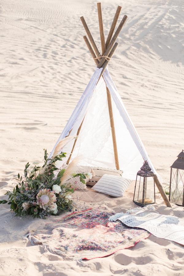 beach, sand, pillow, tent, flowers, pillows, blanket, antique lantern,