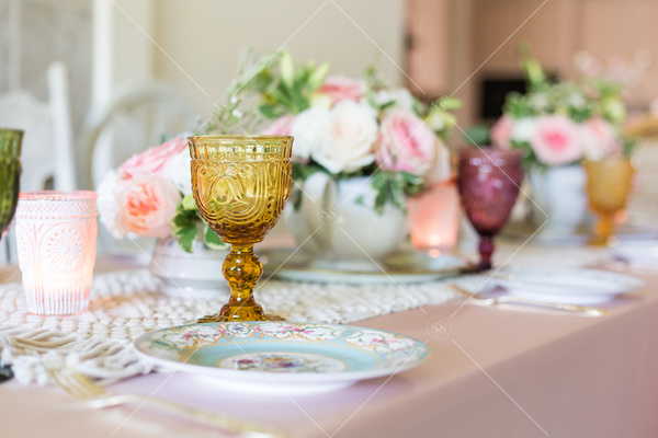 table, dinner table, table settings, decorative wine glasses, floral centerpiece, flowers, plate, silverware, dinning,
