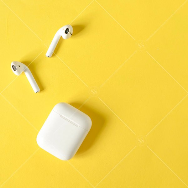 earbuds on a bright yellow background