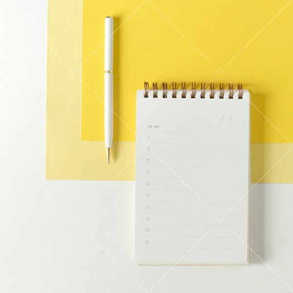notebook and pen with a blank to do list