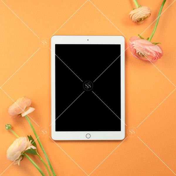 ipad table mockup with coral ranunculus