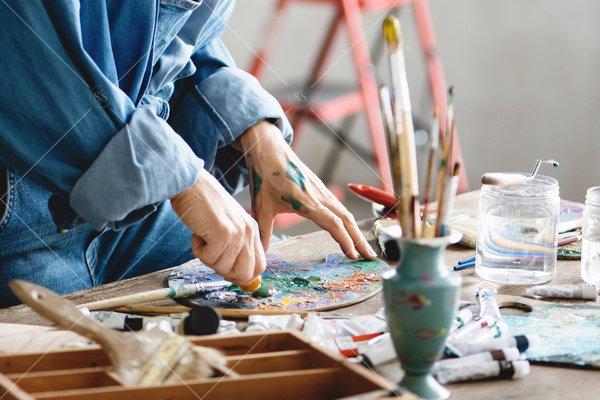 artist mixing paints in studio