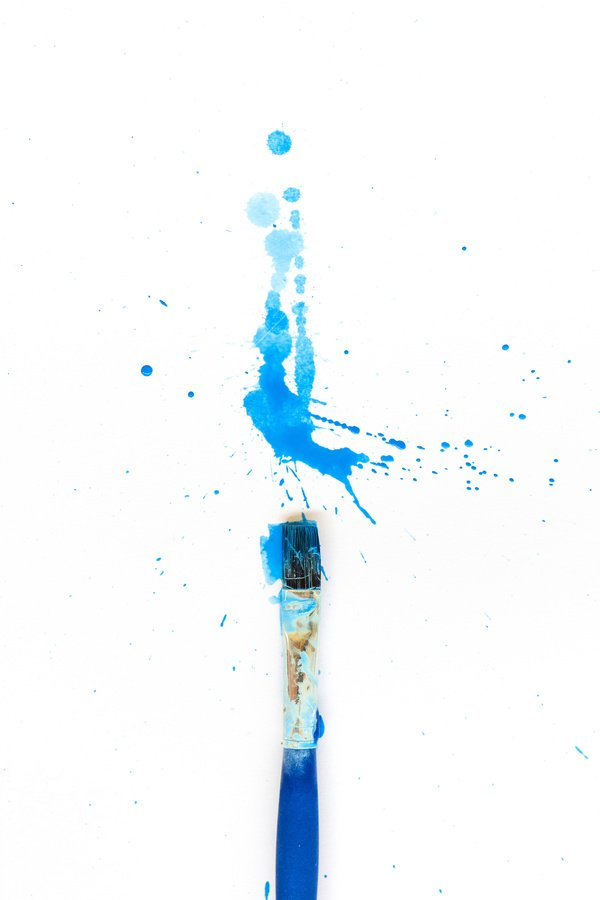 blue paint splatter with paint brush
