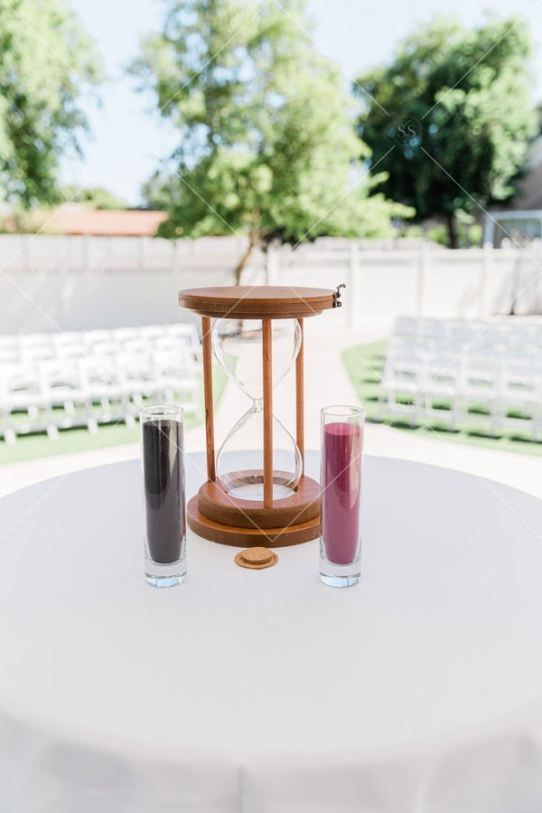 hourglass and candles ready for outdoor wedding ceremony