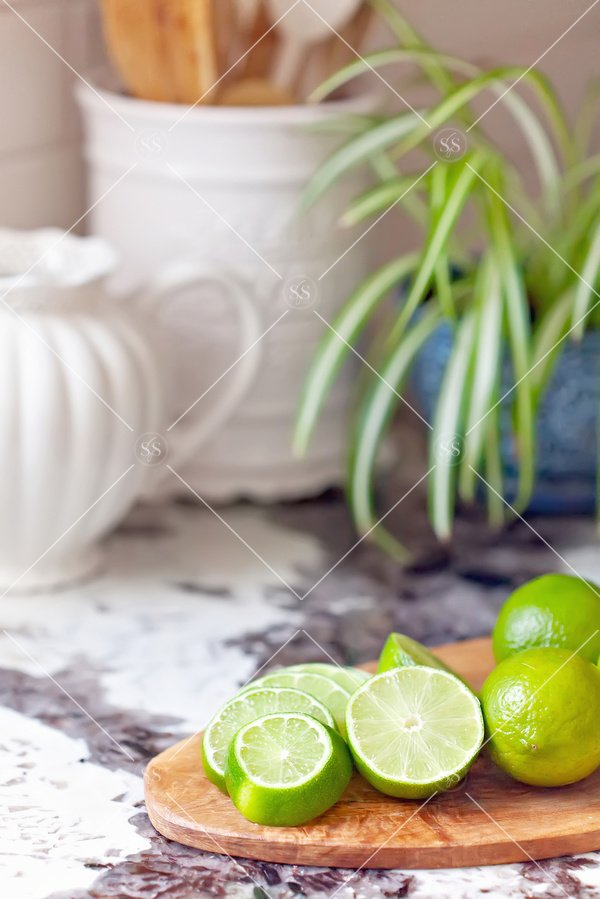 sliced limes on the kitchen counter