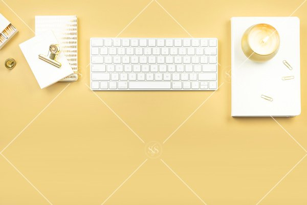 Gold background styled desktop stock photo with white keyboard white book gold candle gold paperclips gold binder clip white notepad white matches and gold stamp
