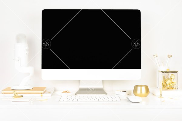 White and gold desktop lifestyle stock photo imac desktop computer on desk with white keyboard gold candle white book gold binder clips and white and gold pencils with white podcast mic
