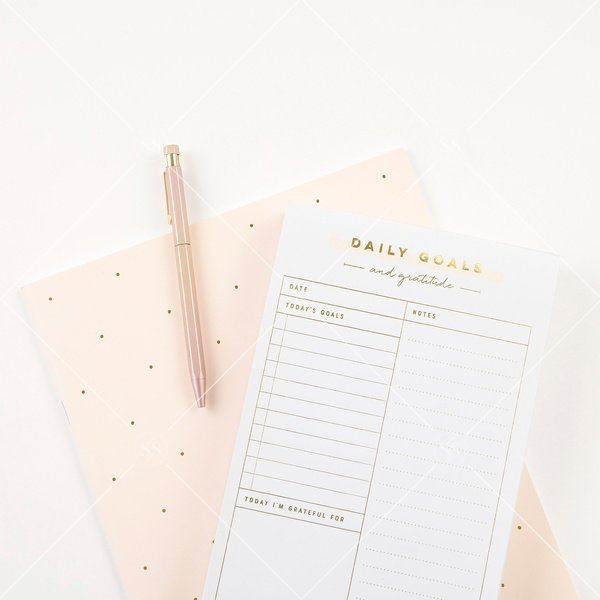peach notebook and notepad