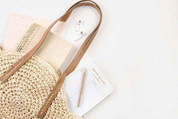 notebooks in a woven bag