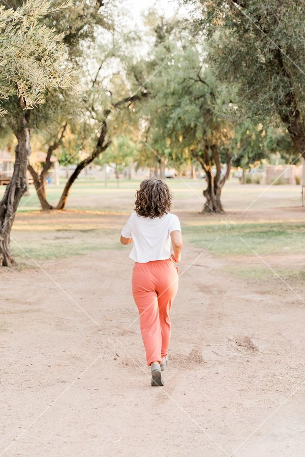 Woman running outside in the park