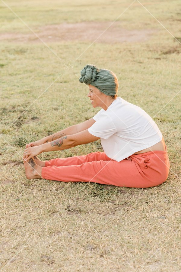 Woman stretching in the grass