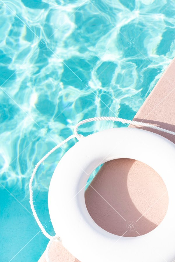 Turquoise pool with life preserver