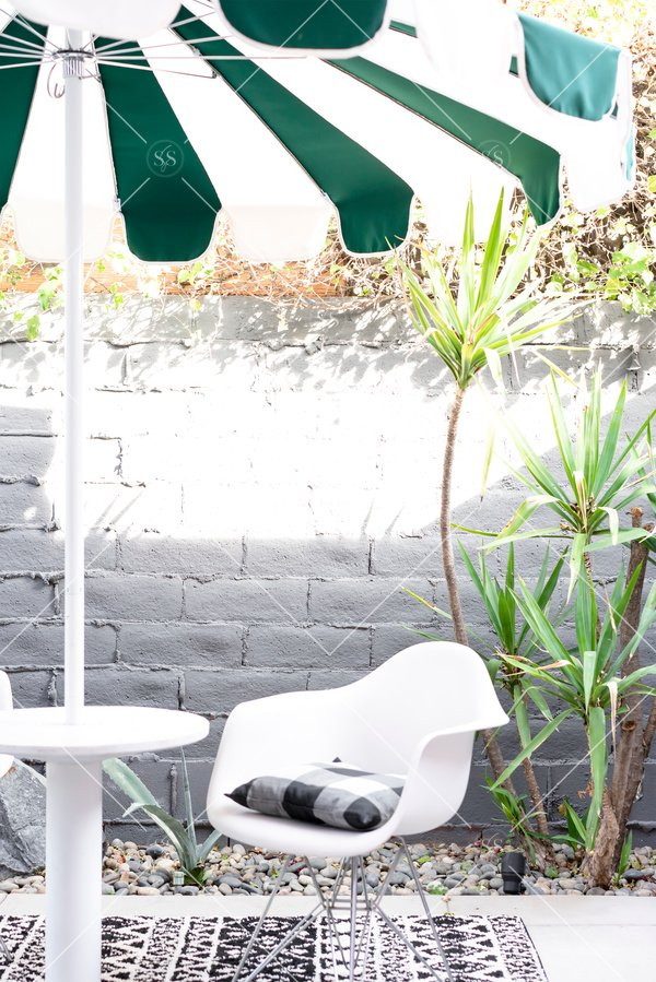 Umbrella and chairs on patio